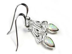 Beautiful sterling silver earrings with a Celtic design and featuring synthetic opal teardrop faceted stones. Matching the Celtic trinity opal pendant. Opal is the birthstone for October which is believed to symbolise faithfulness. Celtic Designs, Sterling Silver Earrings, Birthstones, Swarovski Crystals, Opal, Pendant, Beautiful, Birth Stones, Hang Tags