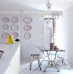 not sure if I am more in love with the table legs or the plates on the wall......