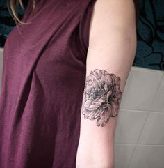 Peony on bicep by Romain Kew