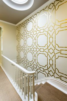 Our Contempo Trellis wall stencil is shining bright in this stairwell. What a great look! Interior Design by @Kress Jack at Home,