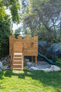 Today is the big 'Castle Clubhouse' reveal . don't worry, we're cancelling Christmas and birthdays this year because, well . our kids got a 'Castle Clubhouse.' We partnered with Wood, Naturall Backyard Fort, Backyard Cookout, Backyard Playground, Backyard For Kids, Backyard Ideas, Diy Playhouse, Backyard Playhouse, Kids Castle, Bateau Pirate
