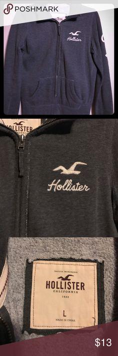 "Grey Hollister Zip Up Sweatshirt Great condition!! Grey Hollister sweatshirt with zipper and front pocket. Cream color lettering, ""California"" in script down sleeve. Comfy cozy! Hollister Tops Sweatshirts & Hoodies"