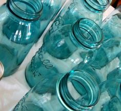 These would make perfect table decorations with white or light pink flowers and ribbons tied around the mouth. If I can't find blue jars I'll use food coloring to make blue water.