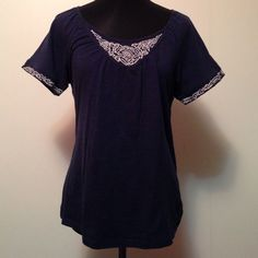 Navy Blue Short Sleeve In good shape. Loose fitting. Size small but would fit also medium. Dark navy blue color with white stitching Faded Glory Tops Blouses