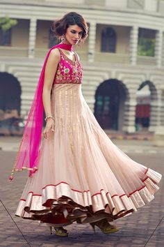 Pretty pink is the best blush a girl can wear! Get this gorgeous anarkali salwar kameez suit from #aishwarya store in Mumbai & Ahmedabad or shop anarkali salwar kameez suit online at http://www.aishwaryadesignstudio.com/readymade%20dresses/16147-stunning-pink-beige-color-net-fabric-anarkali-suit.aspx