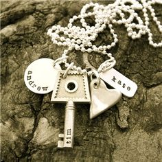 """Got this sweet gift for my 30th Birthday... thanks mom & daddy! :: Love this Lisa Leonard necklace!! (on the 18"""" fine link chain, """"emma"""" on round tag, """"rylie"""" on skinny tag, """"jason"""" on key)"""