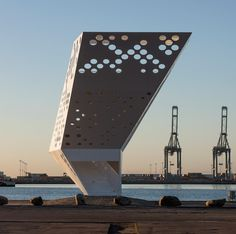 White perforated steel observation tower at Aarhus Harbour by Dorte Mandrup