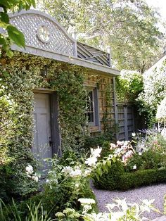 I really love the idea of the star jasmine up the trellis all over the wall. I would like this by the front door :)