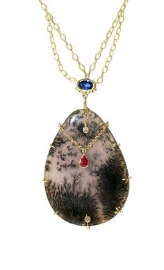 An exceptional pendant by Unhada jewelry. Gemstones and quartz in gold.