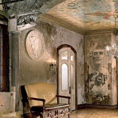 Gerard Butler's New York Loft. Artists Jon De Pabon and Paul Kendall painted the mural on the entrance hall's ceiling. Beautiful chandelier,also.
