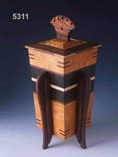 Decorative wood cremation urns can be used as burial urns or to keep in your home. Cremation Boxes, Cremation Urns, Woodworking Box, Woodworking Projects, Custom Wooden Boxes, Wooden Jewelry Boxes, Wooden Hinges, Burial Urns, Funeral Urns