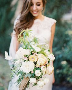 A Romantic, Urban Wedding in Austin, TX | Martha Stewart Weddings - Sprout Floral and Event Design created the Afton's romantic wedding bouquet using textured greenery, roses, and ranunculus.