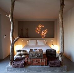 I like this poured concrete bed platform with the tree trunks set in as bed posts.