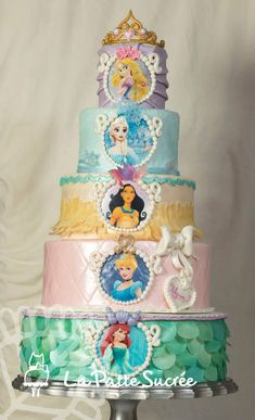 Disney Princess This is a five tiers cake with all her favorite princesses!! I used a lot of wafer paper to add a bit of lightness with all...