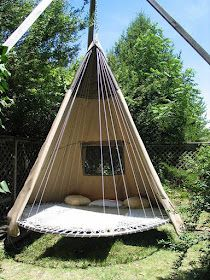 "Repurposed trampoline with tent attachment. ""Suspended TeePee"" for outdoor lounging or sleeping outside in the backyard."