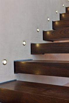 Lights for stairways are as crucial as the lighting of any rooms in your house. A good lighting for the stairs should not be underestimated. The dark stairways might cause a . Interior Stair Railing, Brick Interior, Stair Handrail, Stair Lighting, Cool Lighting, Futuristic Lighting, Types Of Stairs, Stair Storage, Stairs With Storage