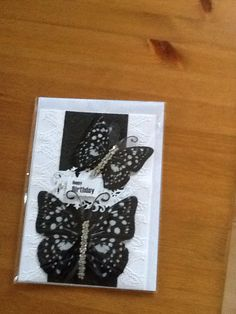 A5 card with an embossed background with central panel in black, with 2 butterfly's with a Happy Birthday sentiment in the middle of the card. Comes with a butterfly insert and envelope.