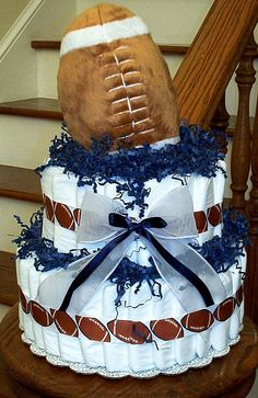 Football diaper cake @Jana June Konkolewski ~ I could do something similar to this, but change it to Crimson Tide ;)