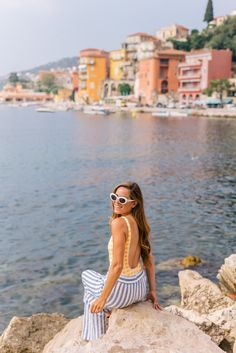 Discover the brightly colored seaside town of Villefranche-Sur-Mer through the lens of Julia Engel of Gal Meets Glam on her trip to the French Riviera. Beach Gear, Beach Pants, Villefranche Sur Mer, French Lifestyle, Italian Summer, Striped Swimsuit, Sand And Water, Gal Meets Glam, French Riviera