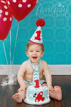 cake smash photographer in winston-salem, nc | baby photographers in high point, clemmons, greensboro | birthday photography and one year mini sessions | airplane clouds red polka dots blue teal chevron tie, diaper cover and hat