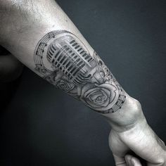 Incredible Musical Notes Tattoo With Microphone And Flowers Guys Forearm