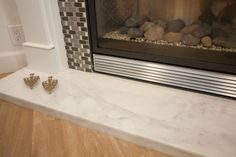 Caldia Marble gives this fireplace a luxurious finish.