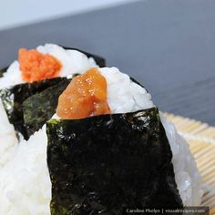Onigiri (Japanese Rice Balls) - Onigiri is a less fancy version of sushi maki, usually filled with ume (Japanese pickled plums), mentaiko (spicy fish roe), okaka (bonito flakes and soy), tarako (salty cod roe), tuna mayonnaise and kombu (Japanese pickles). These are great for snacks as they are healthy and filling....... (from Visual Recipes
