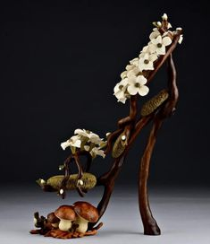 Each twist, turn, bend and fold of the life size sculptural wood shoes are carved with individually executed pieces fitted together, then finely sanded and oiled to enhance the beauty and natural colors and grain of the wood.Dogwood Branch and Moss Shoe.The Art Work Of Denise Nielsen and George Worthington. http://www.oilswoodstone.com/