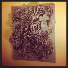 3D wall art: faux flowers hot-glued to canvas; spray-painted with Krylon Gray.
