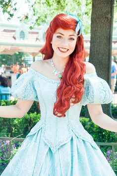 I love this dress and I love Ariel one day I am going to make a dress just like this and wear it to a ball or something :D