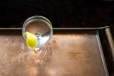 Fitty-Fitty Martini: The Martini spent the better part of the '80s and '90s as a stripped-down, mostly-gin (or, gasp, vodka) version of itself. In an effort to reintroduce America to the joys of dry vermouth and orange bitters, Audrey Saunders created the sophisticated Fitty-Fitty cocktail at her New York City bar, Pegu Club.