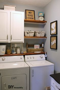 Great laundry room shelving. I really like that small shelf right above the washer and dryer. It would prevent stuff from falling behind.
