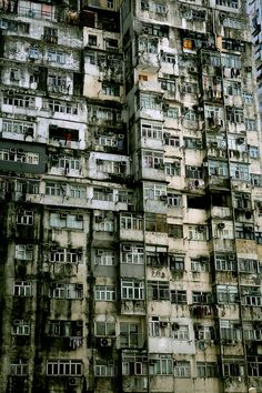 The Kowloon walled city in Hong Kong. Once the most densely populated place on the earth. Now the derelict sky-scraping ghettos fall without an ear to hear them.