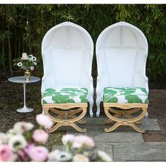 White leather birdcage chairs by the pair.