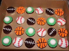 sports themed cupcakes by Kat