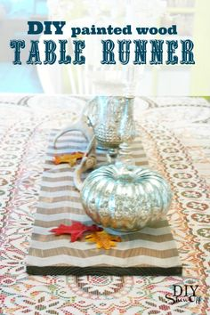 One that wouldn't have to be laundered and ironed every time someone spilled a drink... DIY painted chevron wood table runner at diyshowoff.com