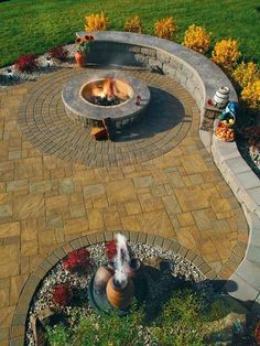 Stamped Concrete Patio with Landscaping Wall