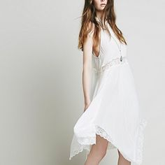 Lace & Sultry Carefree Halter Dress Free People Sheer & Sultry dress in ivory color. This sleeky and carefree halter lace slip is perfect for those cool fresh nights or days.  Lace trim along the uneven hemline and waist make it the perfect choice.  Actual pictures coming up! Free People Dresses Asymmetrical
