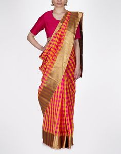 Raw Mango is known for their use of bright colours on beautifully handwoven saris. We particularly love their bright checked saris with elegant gold borders. The checks are spunky and modern, and yet the saris, when worn with earrings, convey a very vintage simplicity.