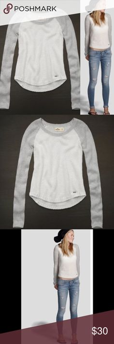 Hollister Malibu Shine Sweater Sparkle Gray White Hollister Malibu Shine Sweater Size XS White with light gray sleeves Baseball style Glitter sparkles woven into fabric  Supersoft Pretty shine fabric Curved hem Relaxed neckline Ribbed trims Heritage logo engraved metal charm near hem Easy fit  43% Acrylic, 30% nylon, 27% wool Worn twice In very good condition  Please ask any questions  💲Open To Offers💲 🚫No Trades🚫 📦Ask About Bundle Discounts💰 Hollister Sweaters Crew & Scoop Necks