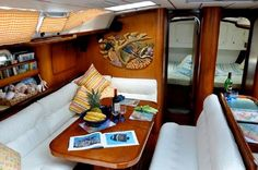 Love the curtains - yellow! http://www.sailboat-interiors.com/ http://www.sailboat-interiors.com/store