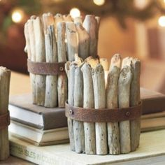 Cute rustic candle holder using drift wood branches. Could be a fun and easy DIY project.:
