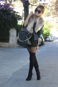 I do love this outfit for the city! #leather #jacket with fur, mini skirt and #booties!
