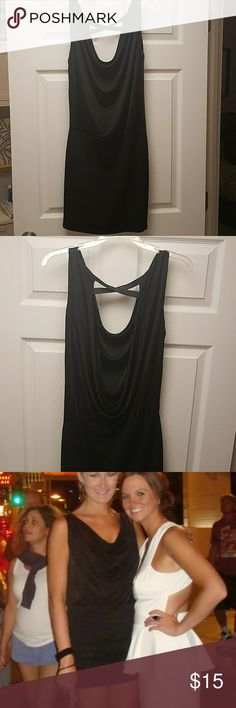 Sexy little black dress Wore this dress once (excuse the awkward pictures but wanted to show how cute it is on!).  Has a drape front and a deep back that crosses at the top.  The skirt part is stretchy and flattering.  I love this dress but sadly doesn't fit.  For reference I am six feet tall. ASOS Dresses Mini