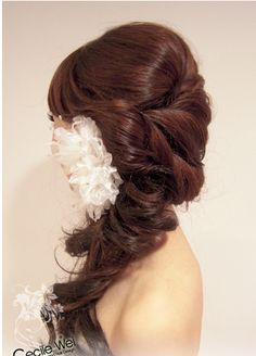 Pretty over the shoulder half up-do with flower.