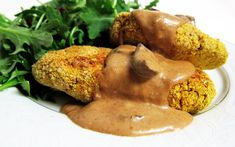 "In this recipe, crispy breaded chickpea cutlets are served with a savory homemade mushroom gravy — and the ""breading"" is gluten-free!"