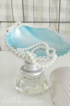 Create your own mermaid  inspired jewelry bowls with some treasures from the beach and a few vintage glass knobs. You will love these placed in a tray to keep all your treasures in. http://dandelionpatina.com #coastal #nautica #mermaids