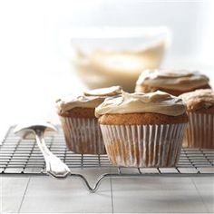 Zucchini Cupcakes Recipe -I asked my grandmother for this recipe after trying these irresistible spice cupcakes at her home. I love their creamy caramel frosting. They're such a scrumptious dessert you actually forget you're eating your vegetables, too! —Virginia Lapierre, Greensboro Bend, Vermont