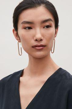 COS image 3 of Chunky metal hoop earrings in Gold