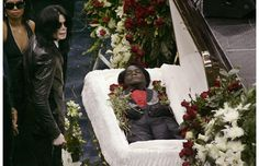 So sad.This image shows Michael Jackson approaching the Godfather of Soul's open casket, when he reportedly bent down and kissed James Brown's body. Brown had three memorial services that included a public viewing of his body.